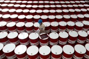 Oil jumps on Chinese factory growth, hopes for deeper OPEC cuts