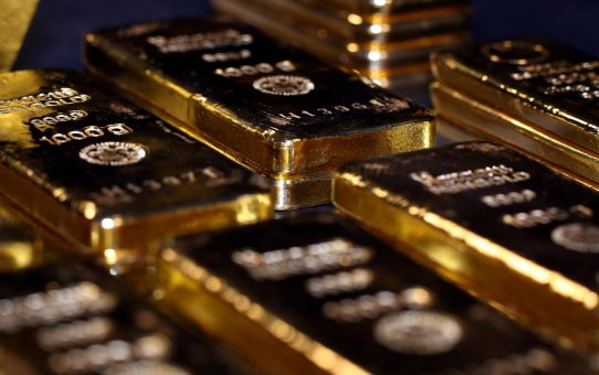 Gold extends gains on surprise Fed rate cut